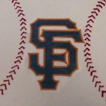 The SF GIANTS logo on a baseball cake.