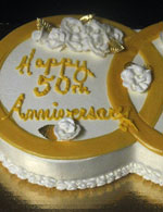 Inter-locking gold rings for a 50th wedding anniversary cake