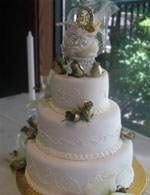 50th wedding anniversary cake in rolled fondant with gold roses