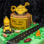 Baby boy under construction fondant 3-D baby shower cake