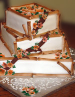 Stacked square rolled fondant wedding cake with hand-made fondant bamboo edging and flowers