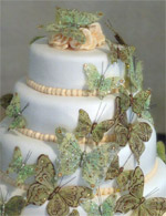 Stacked rolled fondant wedding cake with a butterfly cascade.