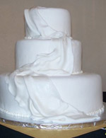 Draped rolled fondant wedding cake.
