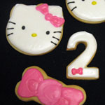 Hello Kitty cookies with matching bows and twos.