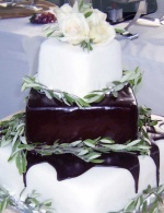 Sugared olive branches and chocolate ganache on square rolled fondant wedding cake