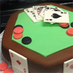 Rolled fondant card table with a roal flush - poker game cake.