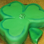 A fondant covered shamrock cake decrated to perfection, a Gristmill custom cake