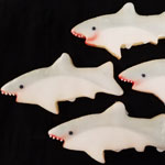 Cut out shark cookies with detail.