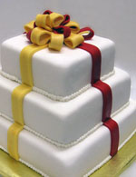 Stacked double layer packages with a fondant bow.