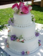 Stacked cake with fresh roses.
