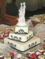 Stenciled rolled fondant wedding cake with matching cupcakes