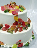 Stacked wedding cake with fall color and acorns.