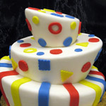 A whimical cake in primary colors.