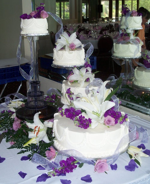 Spectacular 4 Tiered Wedding Cake On Crystal Pillar System With Colored Fountain And Fresh Flowers